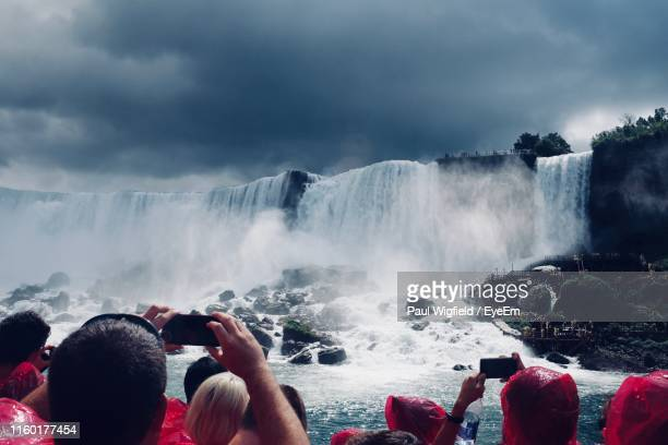 people photographing waterfall - canada stock pictures, royalty-free photos & images