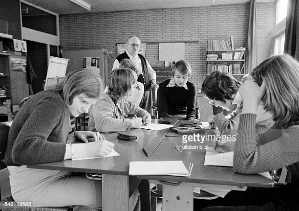 People, physical handicap, school lessons, class teacher supervises pupils and schoolgirls during a classwork, also a trainee sits there, aged 60 to...