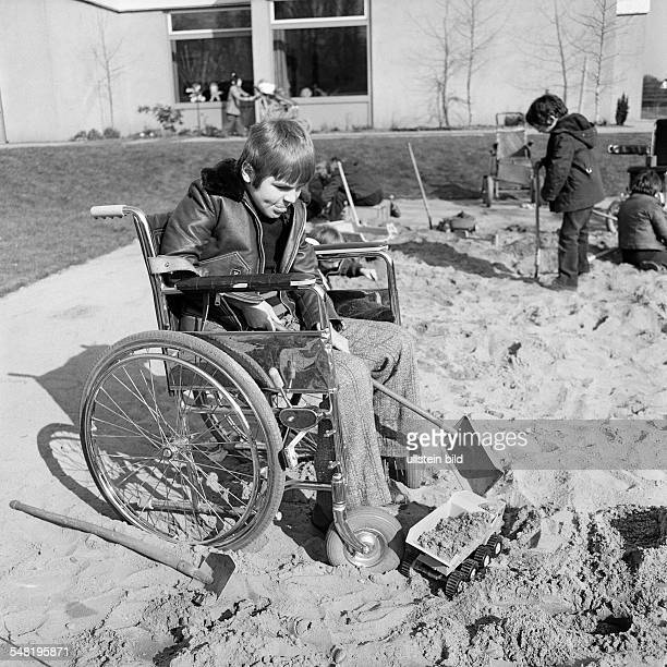 People, physical handicap, school, study break, schoolyard, boy plays with shovels in a sandpit, aged 10 to 14 years, Special School Alsbachtal,...