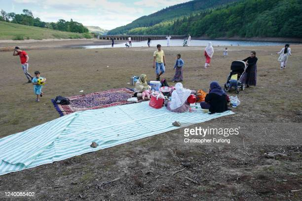 People picnic on the exposed Ladybower reservoir bed due to reduced water levels after the UK recorded the the driest May on record since 1896 on...