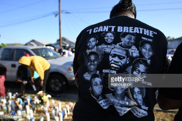 People place candles at a makeshift memorial on September 1, 2020 in Los Angeles, California at the location where Dijon Kizzee was shot and killed...
