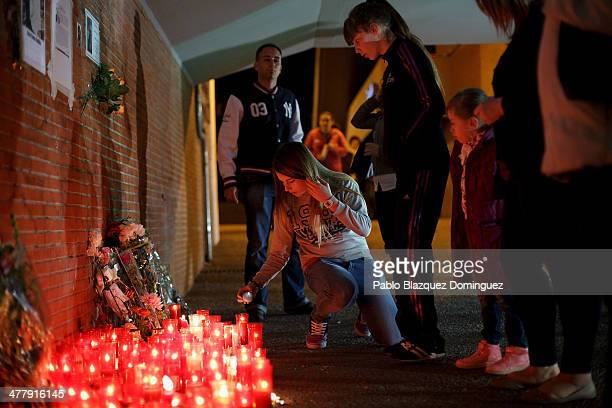 People place candles for the victims of Madrid train bombings at El Pozo train station during the 10th anniversary on March 11 2014 in Madrid Spain...