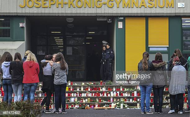 People place candles outside the school in Haltern which is about 40 miles from Dusseldorf on March 25 2015 to commemorate 16 students of JosephKonig...