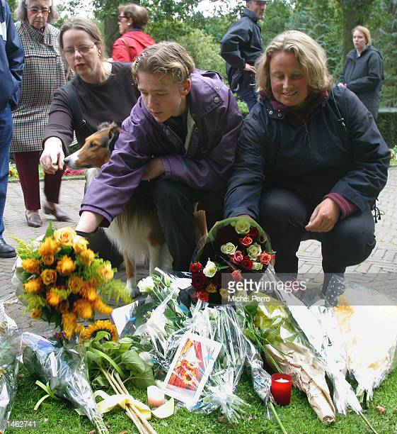 People place flowers at royal Palace Huis ten Bosch October 7 2002 in The Hague The Netherlands Prince Claus husband to Queen Beatrix died October 6...