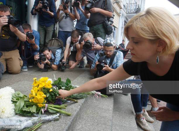 People place flowers in commemoration of the victims of Malaysia Airlines MH17 plane accident in eastern Ukraine in front the Dutch embassy in Kiev...