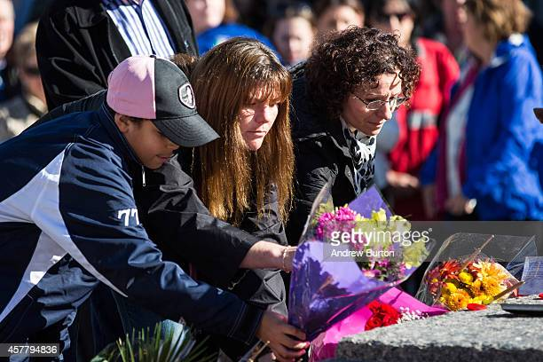 People place flowers in rememberance of Cpl Nathan Cirillo during a ceremony at the National War Memorial on October 24 2014 in Ottawa Canada Two...