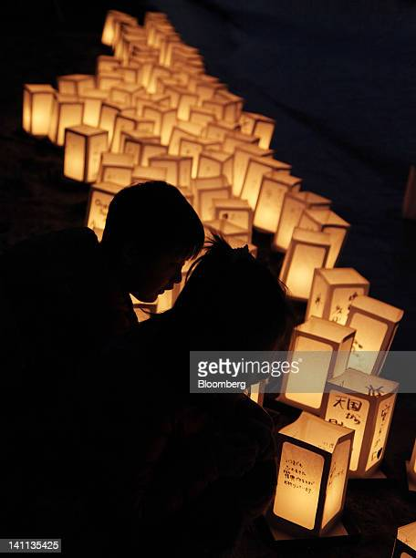 People place lanterns on the sea to commemorate the oneyear anniversary of the Great East Japan Earthquake and Tsunami in the Odaiba district of...