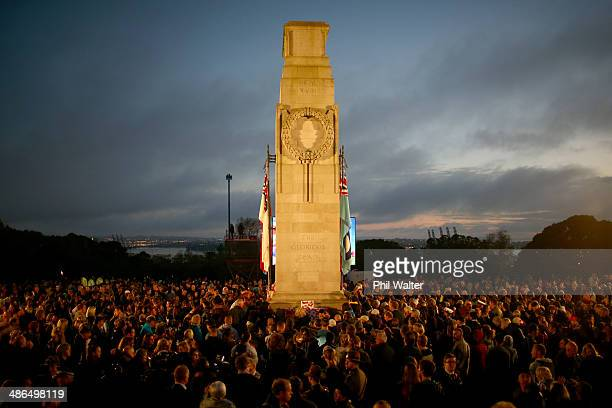 People place poppies on the cenotaph at the War Memorial Museum on April 25 2014 in Auckland New Zealand Veterans dignitaries and members of the...