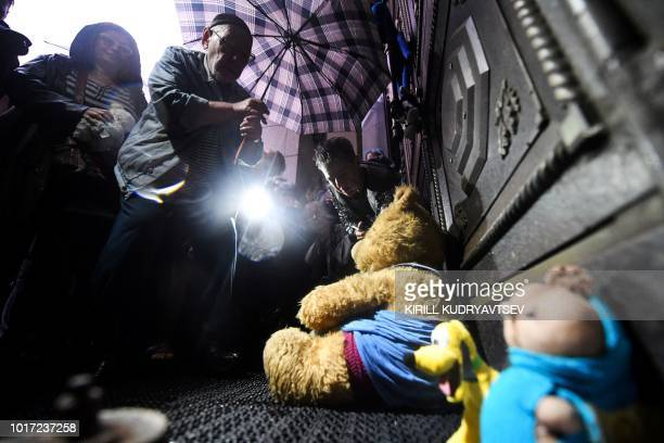 People place stuffed toys in front of the Russian Supreme Court during a rally to demand the release of two teenagers accused of 'extremism' in a...