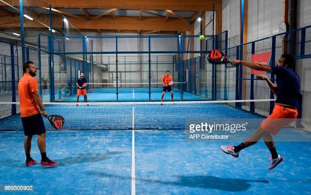 People play a padel match on October 10 2017 in Bois d'Arcy near Paris Tennis champions like Nadal and Monfils have raise a new interest in padel a...