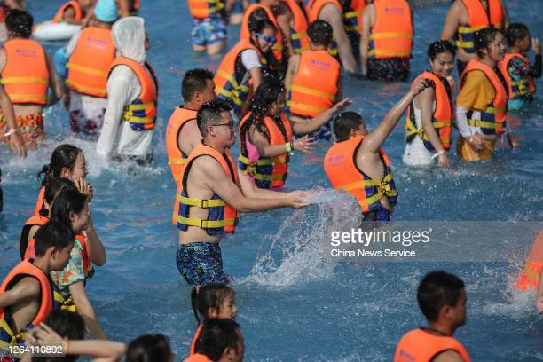 People play at a water park to escape the heat on August 5, 2020 in Guiyang, Guizhou Province of China.