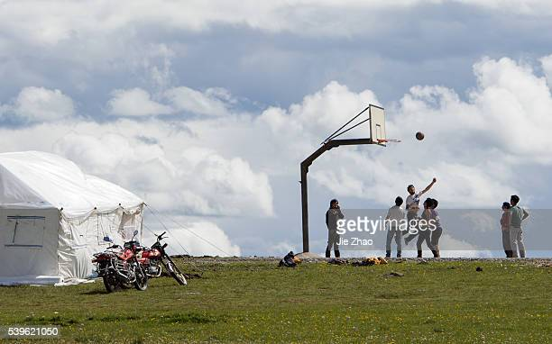 People play basketball in a small village in Aba county Sichuan province southwest China on 27th June 2015