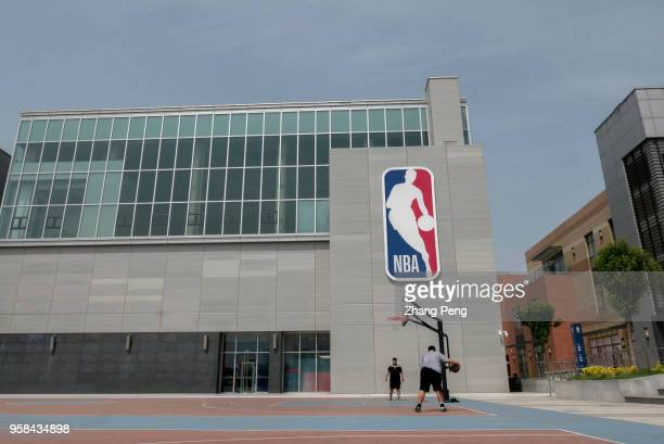 People play basketball on an outdoor court of the center NBA China opened its first lifestyle center on April 25 in Tianjin The center covers 12000...