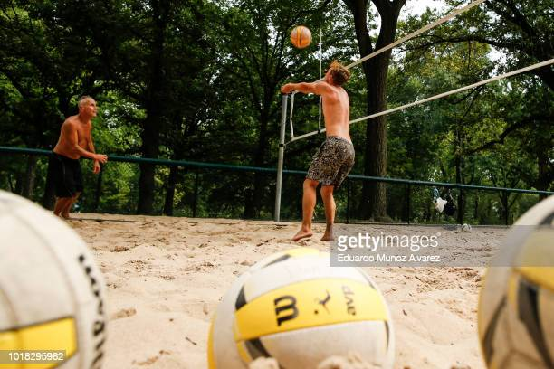People play beach volleyball during a warm day at Central Park on August 17 2018 in New York City Severe thunderstorms and even an isolated tornado...