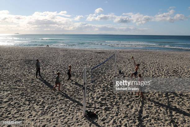 People play beach volleyball on June 09, 2020 in Cambridge, New Zealand. COVID-19 restrictions lifted at midnight as New Zealand moved to COVID-19...