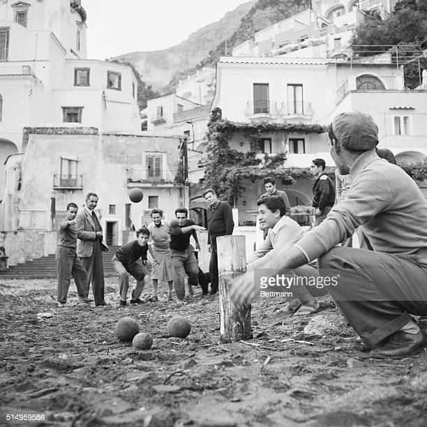 People play bocci in the small Sicilian village of Positano Watching the villagers tossing on the sandy beach are Gregory Eskate and his wife from...