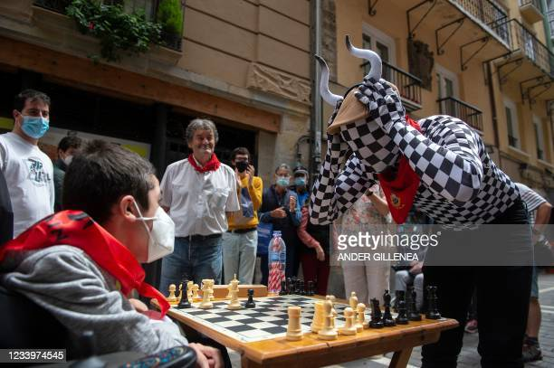 """People play chess in Estafeta street in Pamplona during the """"Chess Run"""" tournament on July 14, 2021. - Some 80 players took part in the """"Chess Run""""..."""