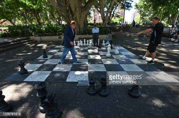 People play chess on a giant chess board at Hyde Park in Sydney on November 26 2020 Hit miniseries The Queen's Gambit has led to a surge of interest...