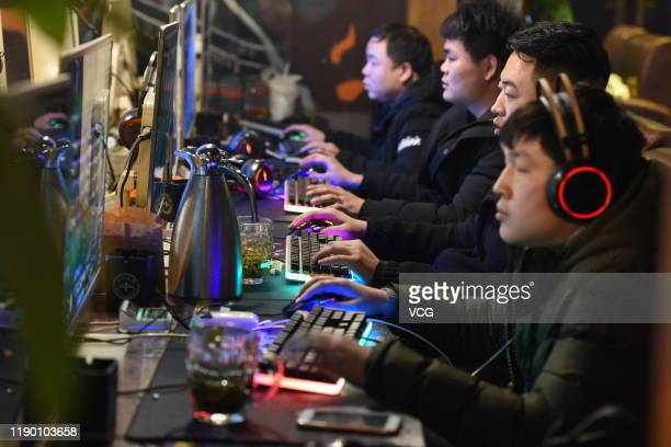 People play computer games at an Internet Cafe on March 1, 2019 in Fuyang, Anhui Province of China.