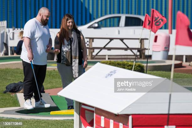 People play crazy golf on March 29, 2021 in Southend, England. Today the government eased its rules restricting outdoor socialising and sport in...