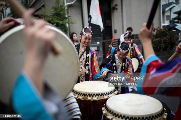 People play drums during a ceremony to celebrate the accession of the new emperor to the throne in the Nakanobu neighbourood of Tokyo on May 1 2019...