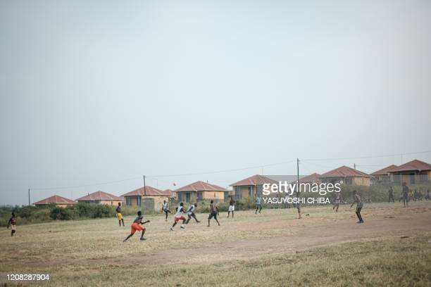 People play football at the Kyakaboga resettlent village built and consructed by the Ugandan government as compensation for people that has been...