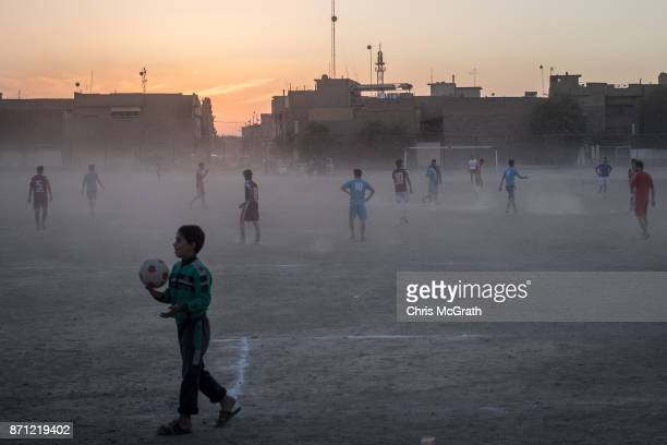 People play football in East Mosul on November 5, 2017 in Mosul, Iraq. Five months after Mosul, Iraq's second-largest city was liberated from ISIL in...
