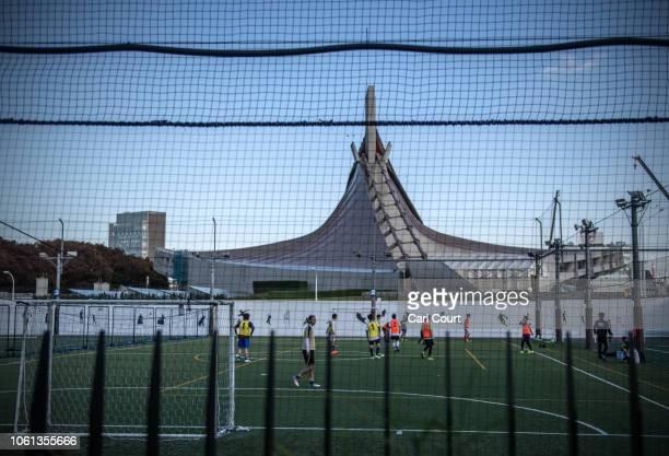 People play football next to Yoyogi National Stadium on November 14, 2018 in Tokyo, Japan. The 13,291 seat stadium is set to host handball during the...
