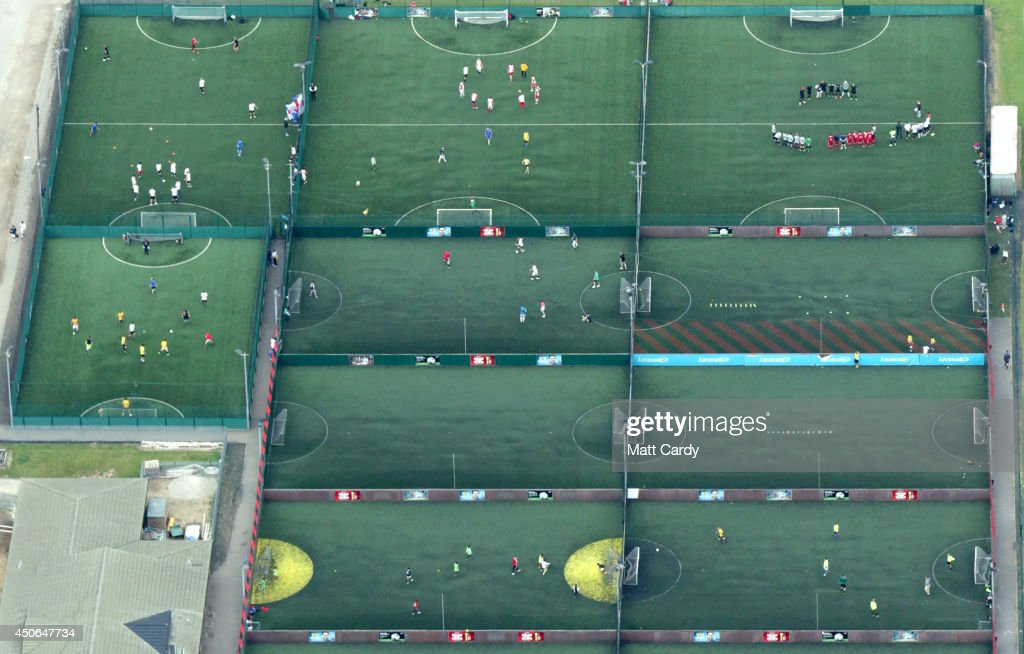People play football on pitches seen from the air on June 14, 2014 in London, England.