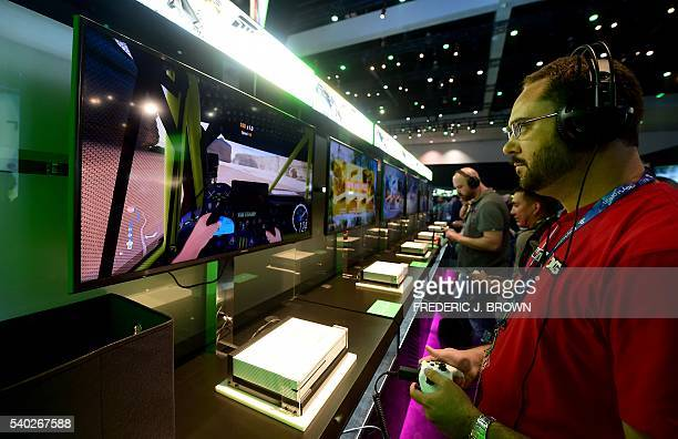People play 'Forza Horizon 3' during the 2016 Electronic Entertainment Expo annual video game conference and show on June 14, 2016 in Los Angeles,...