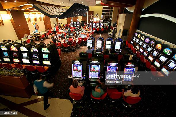 People play games at the Howard Johnson casino where some members of the FOL military base spend their spare time in Manta Ecuador on April 12 2007...