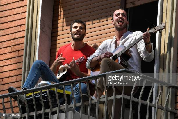 People play guitars and sing the song 'Bella Ciao' on their balcony as part of a flash mob to celebrate Liberation Day. April 25 is the Liberation...