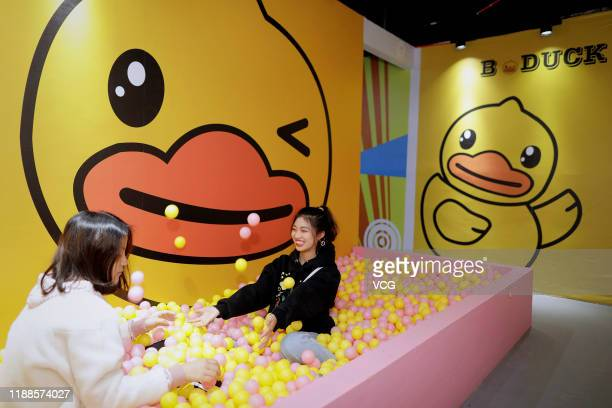 People play in a bathtub full of balls at a stress-relief museum on November 18, 2019 in Suzhou, Jiangsu Province of China.