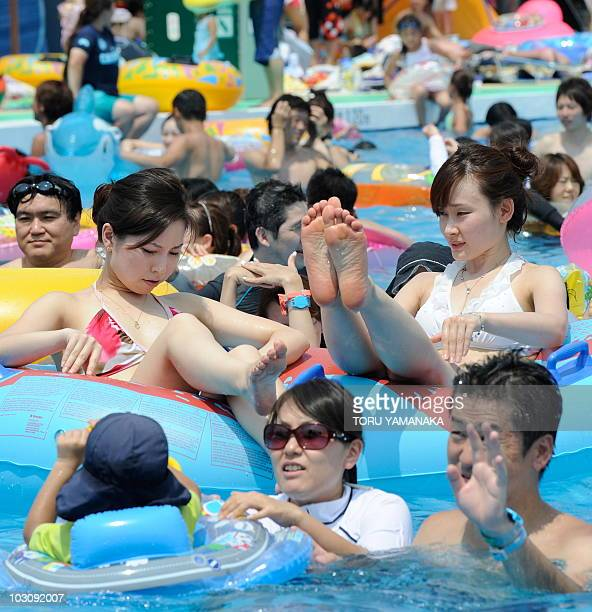 People play in a crowded swimming pool at the Toshimaen amusement park in Tokyo on July 24 2010 Some 10000 people visited the amusement park to enjoy...