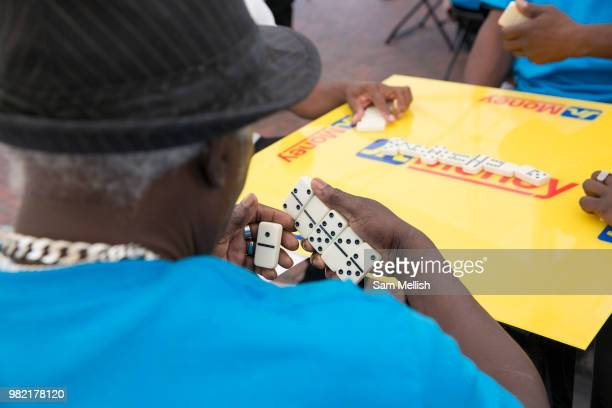People play in a dominoes tournament at Windrush Square to celebrate the 70th anniversary of the arrival of the passenger liner Empire Windrush and...