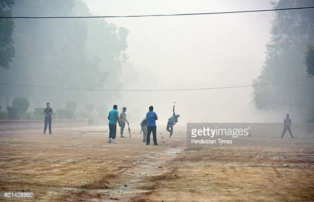 People play in a foggy morning at India Gate as smog covers the capital's skyline on November 6 2016 in New Delhi India New Delhi's air quality has...