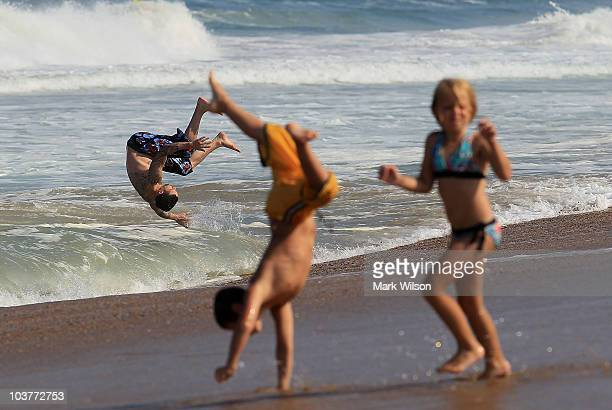 People play in the high surf caused approaching hurricane Earl, on September 1, 2010 in Kitty Hawk, North Carolina. A hurricane warning has been...