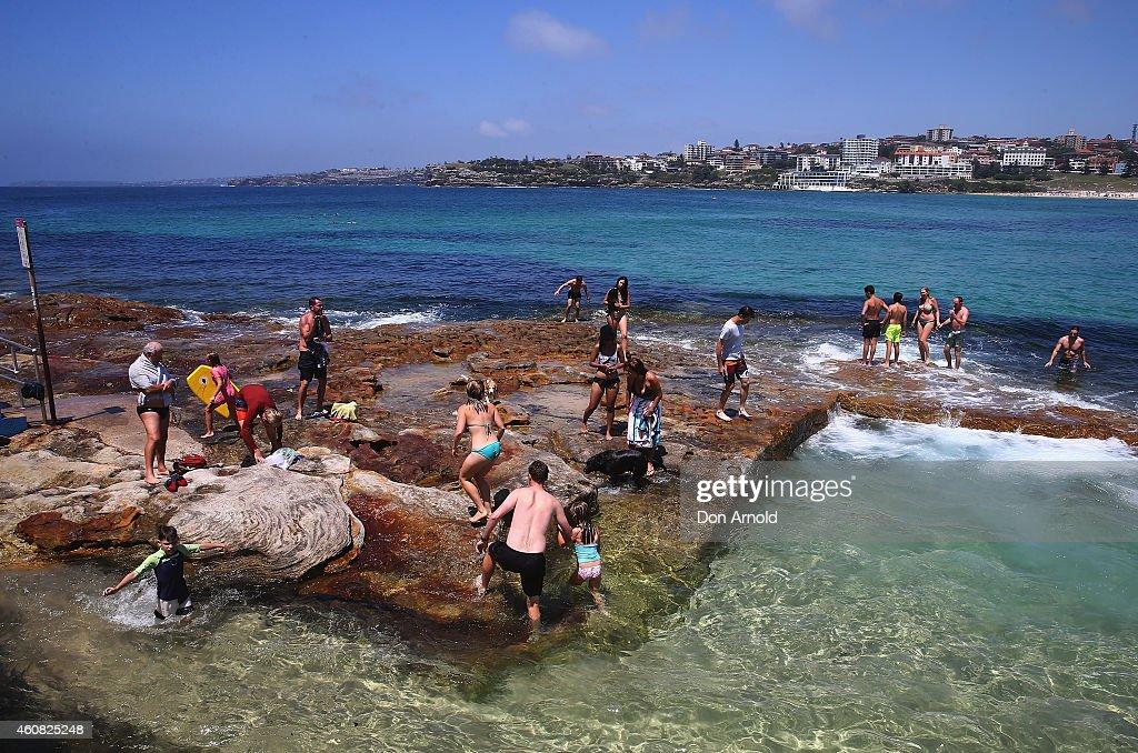 People play in the rock pools at North Bondi at Bondi Beach on December 25, 2014 in Sydney, Australia. Bondi Beach is a popular tourist destination on Christmas Day.