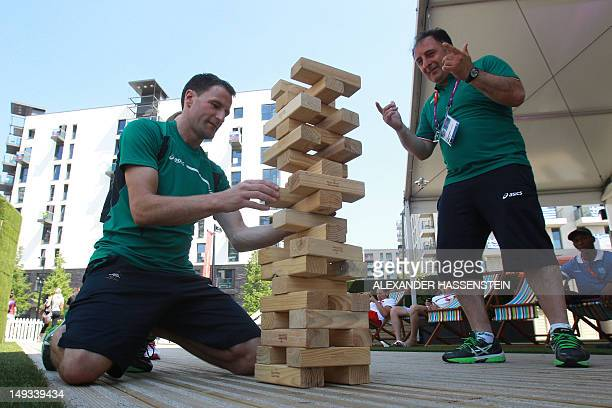 People play Jenga in the Olympic Village ahead of the London 2012 Olympic Games at the Olympic Park on July 26, 2012 in London, England. AFP PHOTO /...