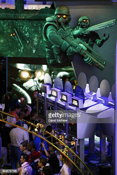 People play Kill Zone in Sony's Playstation exhibit area on opening day of the 10th annual Electronic Entertainment Expo May 12 2004 in Los Angeles...