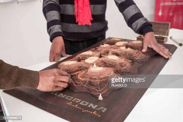 People play on a 3D representation of Fanorona as practiced by the Malagasy military strategists during the royal era, in the capital Antananarivo,...