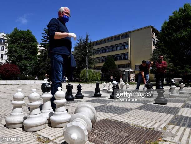 People play outside chess in Sarajevo on May 13, 2020 after a two month lockdown due to the spread of the COVID-19 - Measures of physical movement of...