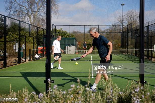 People play Padel Tennis, a hybrid of tennis and squash, played on a small tennis court, in Hyde Park in London on March 29 as England's third...