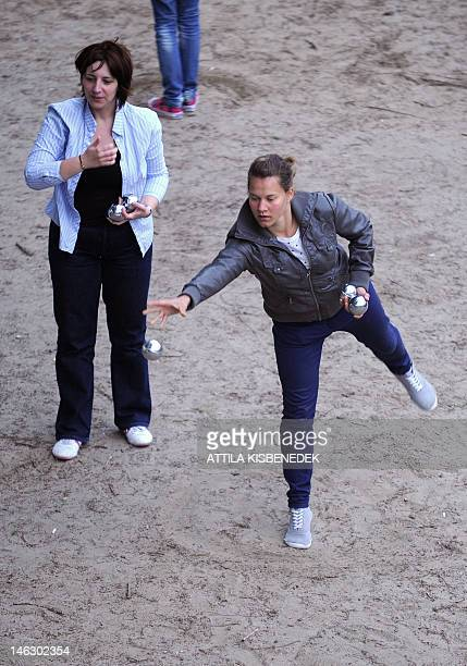 People play petanque on the bank of the Danube River beside the oldest Hungarian bridge 'Lanchid' in downtown Budapeston on June 13 2012 during an...