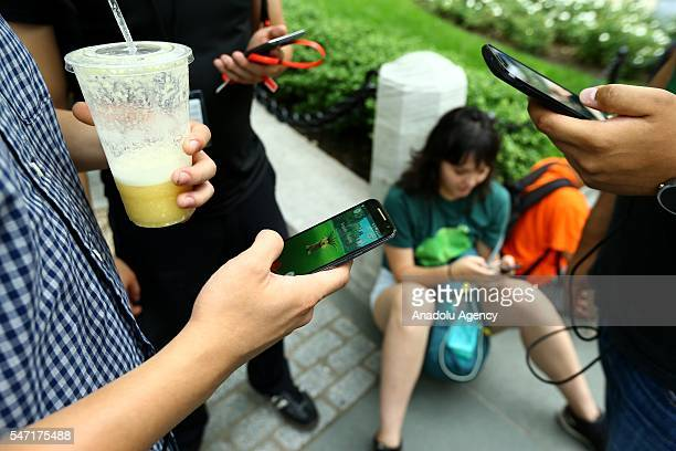 People play Pokemon GO game in New York City NY on July 13 2016 Pokemon Go is a freetoplay locationbased augmented reality mobile game which allows...