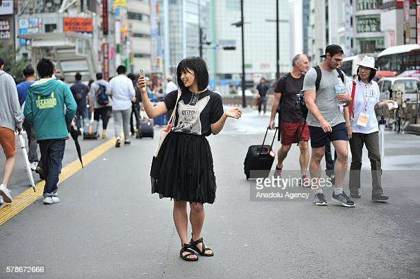 People play Pokemon GO game in Tokyo Japan on July 22 2016 Pokemon Go is a freetoplay locationbased augmented reality mobile game which allows...