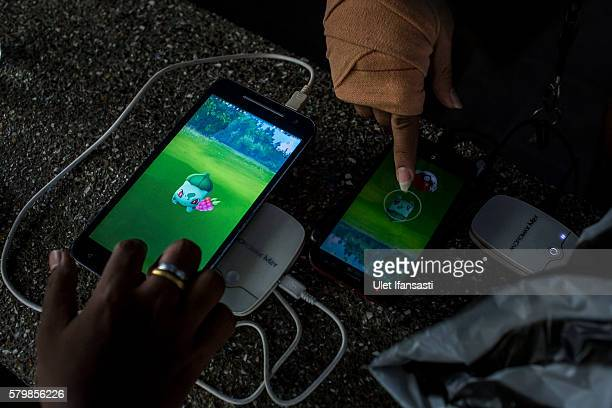 People play Pokemon Go game on smartphones at Gembira Loka Zoo on July 23 2016 in Yogyakarta Indonesia 'Pokemon Go' which uses Google Maps and a...