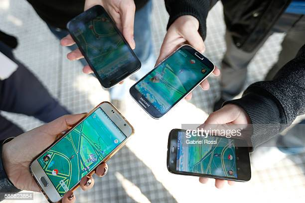 People play Pokemon Go on their smartphones as Pokemon Go craze hits Argentina on August 03 2016 in Buenos Aires Argentina