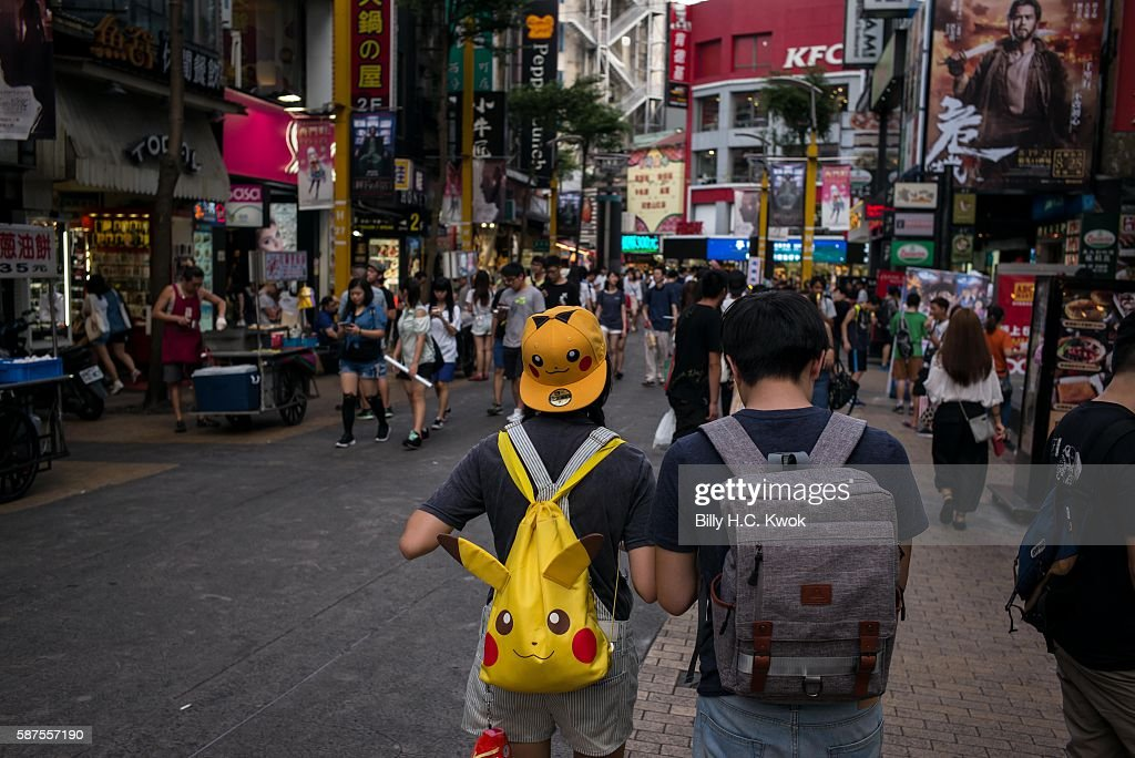 People play Pokemon Go on their smartphones on August 8, 2016 in Taipei, Taiwan. 'Pokemon Go,' which has been a smash-hit across the globe was launched in Taiwan on 6th August. Since its global launch, the mobile game has been an unexpected megahit among users who have taken to the streets with their smartphones.
