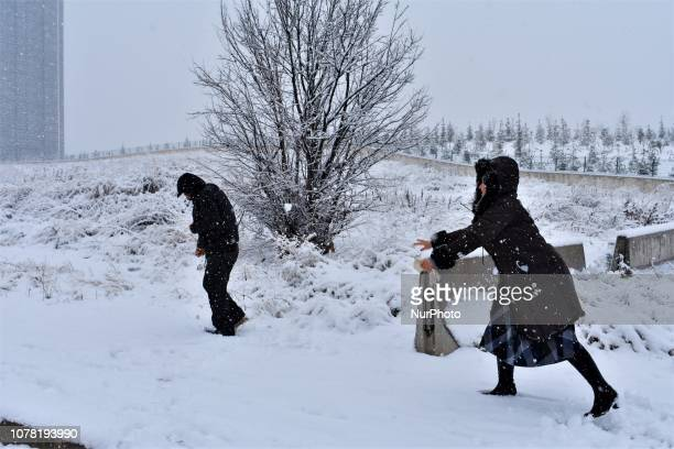 People play snowball during a heavy snowfall in the winter season in Ankara Turkey on January 6 2019